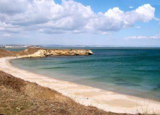 Плаж при залив Стомопло